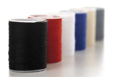 Spools of thread in a row, close-up Stock Image