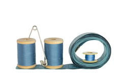Spools of thread with a ruler on a white Stock Photography