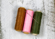 Spools of thread on rustic white wood Stock Images