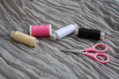 Spools of thread and scissors Royalty Free Stock Image