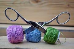 Spools of thread,scissors, stock image
