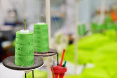 Spools of thread in the sewing equipment. Stock Photography