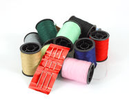 Spools of thread with a sewing needle Royalty Free Stock Photography