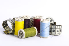 Spools of thread and tape measure Royalty Free Stock Image