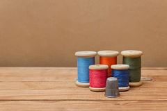 Spools of thread and thimble Stock Image