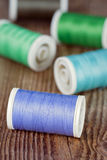 Spools of thread on wooden background Stock Image