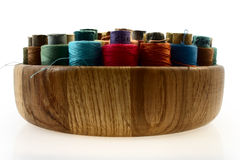 Spools of Thread in wooden bowl Stock Photography