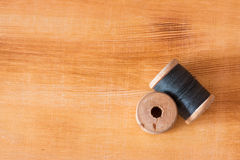 Spools of thread on wooden table Royalty Free Stock Photo