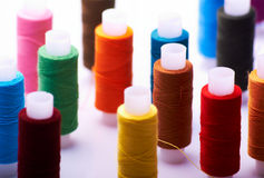 Spools of threads. Multicolored spools of threads. Shallow depth of field Stock Photos