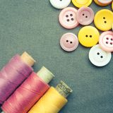 Spools of threads and buttons Royalty Free Stock Photos