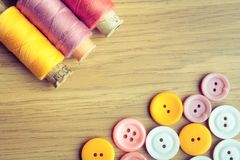 Spools of threads and buttons Stock Photos