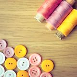 Spools of threads and buttons Stock Image