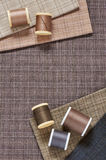 Spools of threads on checkered cotton fabric for quilting and applique Stock Image