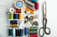 Spools of threads and old scissors Royalty Free Stock Photography
