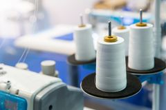 Spools of white threads on sewing machine, closeup Royalty Free Stock Images
