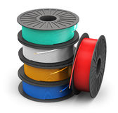 Spools with color electric power cables. Creative abstract electricity and technology engineering industrial business concept: plastic spools with color electric Royalty Free Stock Photos
