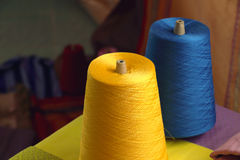 Spools of yellow and blue silk thread for woven in silk cloth Royalty Free Stock Image