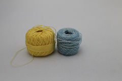 Spools of Yellow and Blue Thread Royalty Free Stock Image