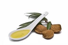 Spoon with almond oil. Royalty Free Stock Image