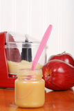 Spoon in apple sauce baby food Royalty Free Stock Photography