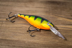 Spoon bait, lures, flies, tackle for catching or fishing a predatory fish on deck wood background Royalty Free Stock Photos
