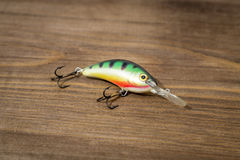 Spoon bait, lures, flies, tackle for catching or fishing a predatory fish on deck wood background Stock Images