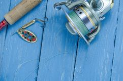 Spoon-baiting, spinning and reel. Decorative background. Fishing Stock Photo