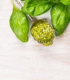 Spoon with Basil pesto and herbs leaves on white woooen background Royalty Free Stock Photography