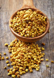 Spoon of bee pollen Stock Photos