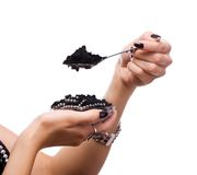 Spoon with black caviar Stock Photo