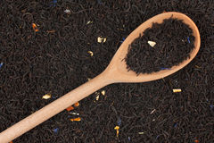 Spoon with black tea Royalty Free Stock Images