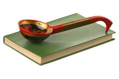 Spoon on the book Royalty Free Stock Photography