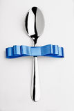 Spoon with bow Stock Images