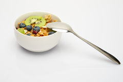 Spoon on bowl of cereal breakfast. Spoon with bowl of cereal muesli Royalty Free Stock Photos