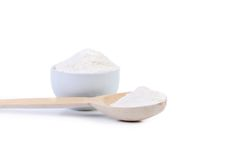 Spoon and bowl with flour. Stock Photos