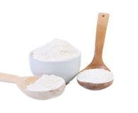 Spoon and bowl with flour. Royalty Free Stock Photos