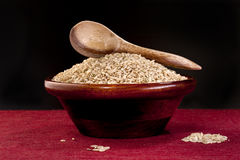 Spoon on bowl of raw rice. Stock Image