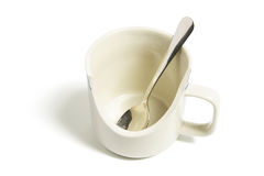 Spoon in Broken Mug Stock Photography