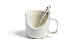 Spoon in Broken Mug Royalty Free Stock Image