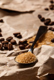 Spoon with brown sugar and coffee beans Stock Image