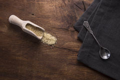 Spoon with brown sugar, on old wooden background. Royalty Free Stock Images