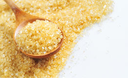 Spoon and cane sugar Stock Photo