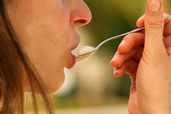 Spoon with capuccino Stock Photos