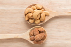 Spoon with cashew nuts and almonds. Royalty Free Stock Photos