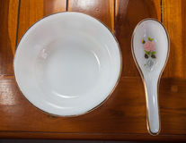 Spoon and cereal bowl empty Stock Images
