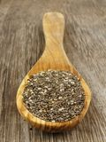 Spoon of chia seeds over wood Stock Photos