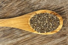 Spoon of chia seeds over wood Stock Images