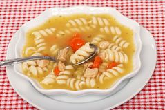 Spoon In Chicken Pasta Soup Stock Photos