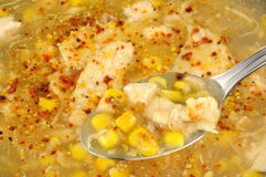 Spoon With Chicken And Sweetcorn Soup Stock Photo