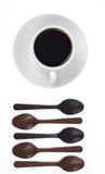 Spoon of chocolate-dessert to cup of coffee Stock Images